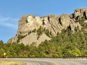 If you stop at the pull out on the road from Keystone it is Roosevelt who looks you in the eye.